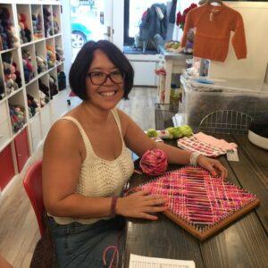 Nancy with Square Loom Weaving in Progress